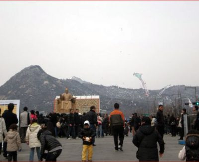 Children fly kites in the crowd on Lunar New Year