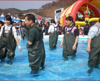 "People playing ""Grab a Fish, Win a Fish"" game"