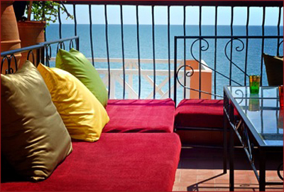 Patio at Dfrost Almugar Surf House overlooking the Atlantic—nice place to kick your feet up and chill