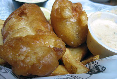 Huge pieces of haddock in a light Killkenny beer-batter, thick potato wedges called 'fat chips' and tangy coleslaw