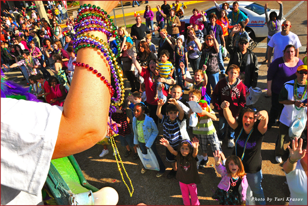 Throwing Mardi Gras beads in Lake Charles, Louisiana