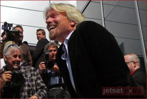 Sir Richard Branson greets the media at the opening of T2 in San Francisco