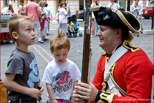 Kids examine a musket at the Boston Harborfest