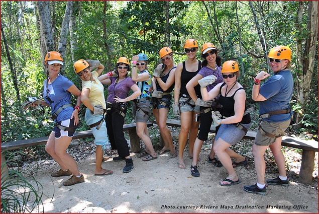 Adventurers outfitted in zip line gear in Riviera Maya