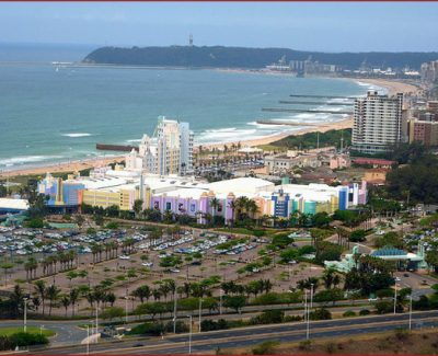 Durban's Golden Mile – Suncoast Casino centre frame with the beachfront and piers in the background