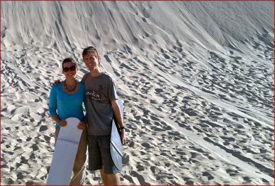 Julianna and Bradley Klose enjoy sandboarding down 30 metre sand dunes. The dunes in Port Stephens make up the largest coastal sandmass in the southern hemisphere