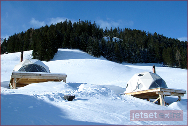 Two of the pods that make up Whitepod in Les Cerniers, Switzerland