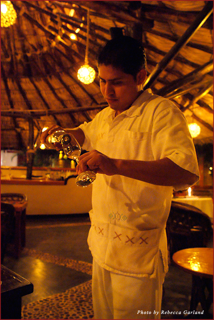 The Tides' bartender, Marco, pours tequila during a tasting at the Coral Bar
