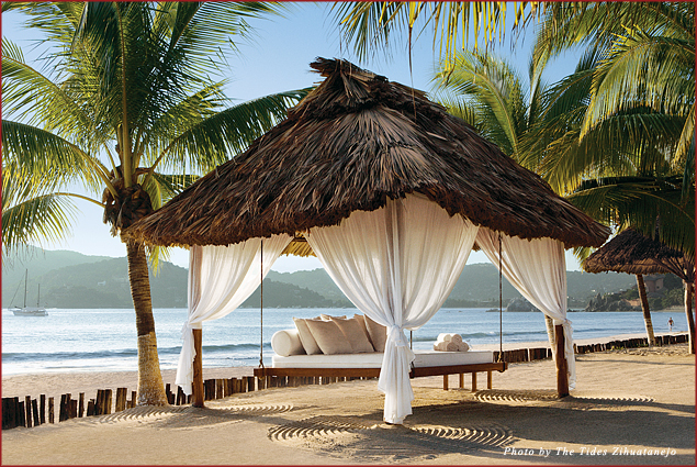 The Tides' guests lounge on suspended palapa beds overlooking Playa La Ropa