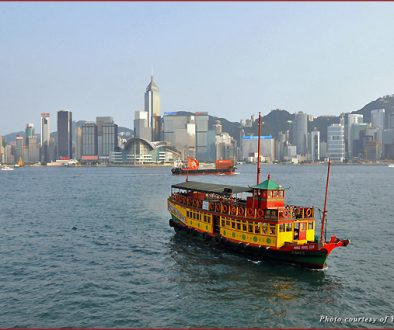 Boat cruising Victoria Harbour in Hong Kong