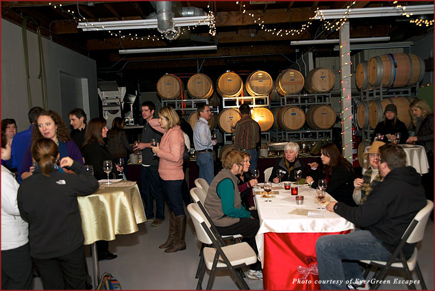 Guests of EverGreen Escapes Holiday Lights and Wine Tour sample the wine