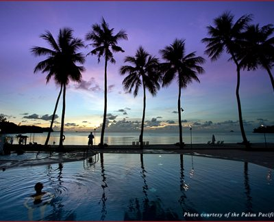 Visitors to the Palau Pacific Resort enjoy a magical sunset