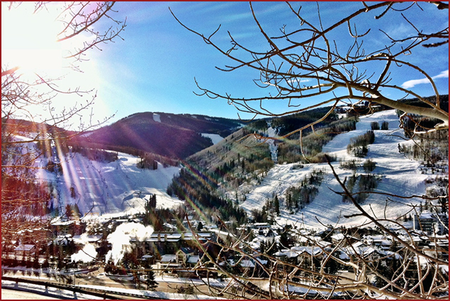 A crisp and sunny Summit County afternoon showcases a beautiful view of the ski runs of Vail