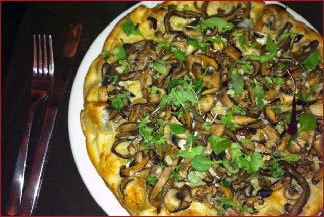 Portobello, button and oyster mushrooms, garlic, Parmesean, microgreens and truffle oil