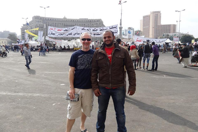 Greg with a stranger in Tahrir Square, the day before the November elections