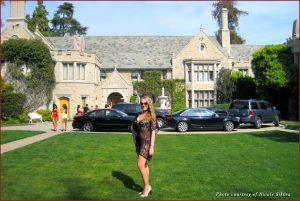 Insider Kathryn Oldenburg in front of the stunning Playboy Mansion in Los Angeles