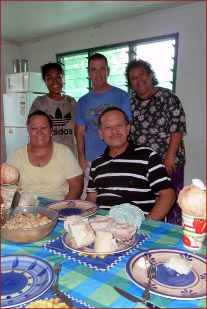 Enjoying a family feast with our new friends in Samoa