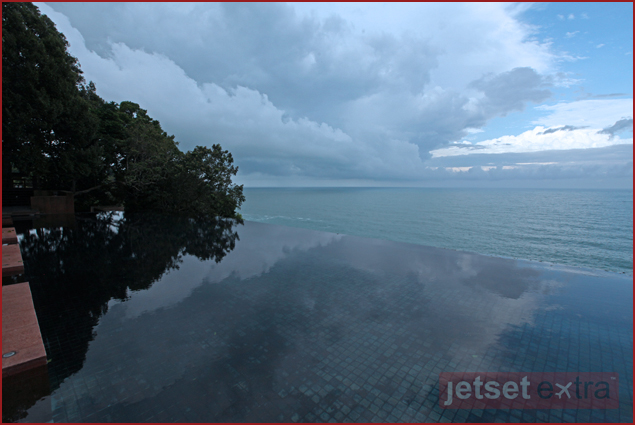 Clouds reflecting off the infinity pool at the Paresa Luxury Resort in Phuket, Thailand