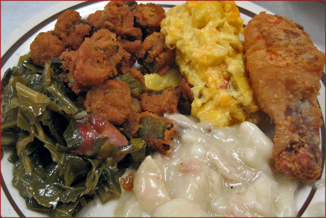 A plate at Martha's with greens, fried chicken, chicken and dumpling's, fried okra and squash