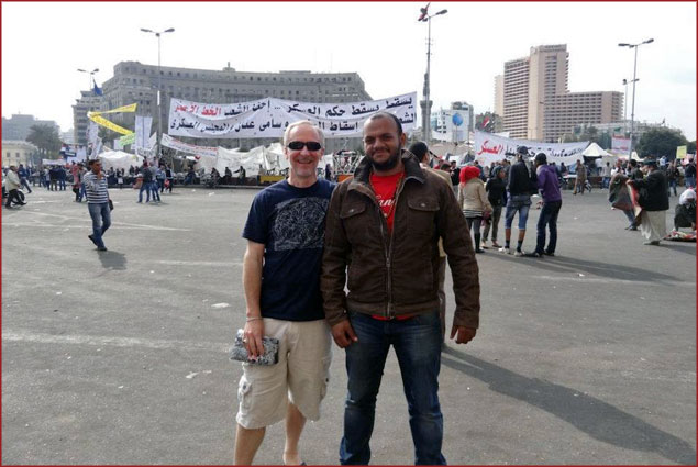 Greg with a local Egyptian in Tahrir Square, Nov. 26, 2011