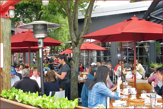 Diners on the patio of the Edible Canada Bistro on Granville Island in Vancouver