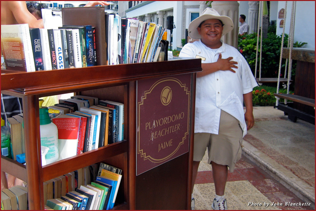 """Beach butlers"" provide books and cold drinks to visitors to Playa del Carmen"