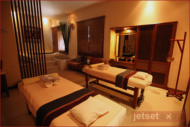 Couples massage room with private jacuzzi tub at Rarin Jinda Spa in Bangkok, Thailand