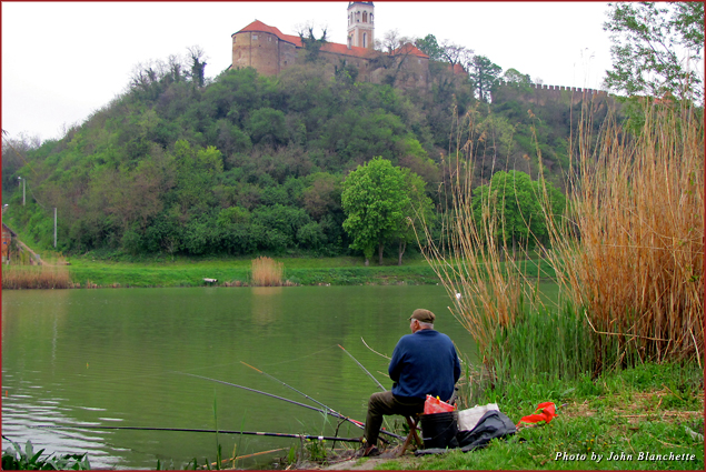 Fishing in the Danube River under a medieval fortress