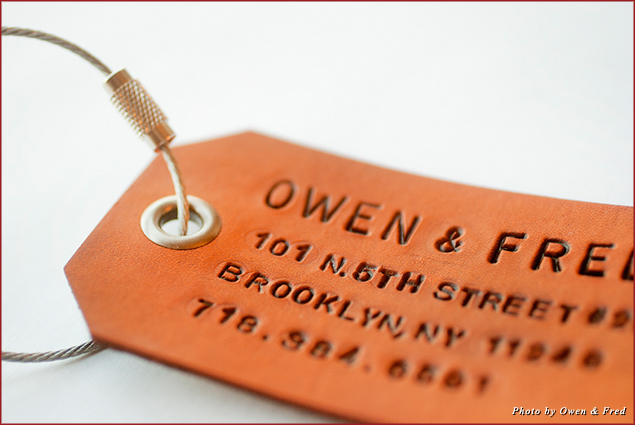 An Owen & Fred Leather Bag Tag