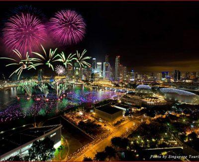 Fireworks light the sky over Marina Bay against the Singapore skyline