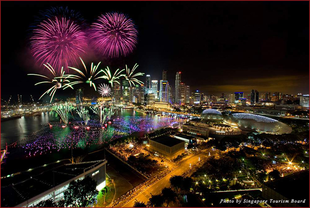 Fireworks light the sky over Marina Bay against the Singapore skyline