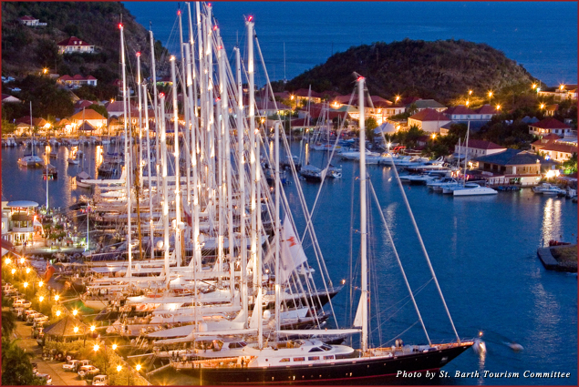 Yacht owners line their vessels along the dock in Gustavia for live music and a midnight fireworks display