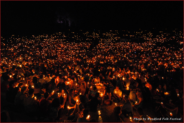 Woodford Folk Festival attendees light thousands of candles to reflect the past year and cast wishes to the future
