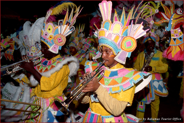 Brightly costumed dancers and musicians join the parade at Junkanoo in the Bahamas