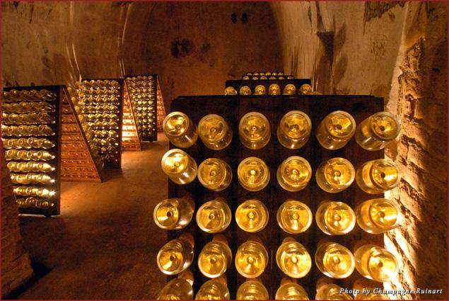 Ruinart bottles in a cellar