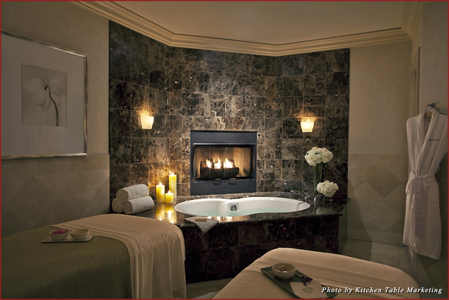 The couples suite at Spa Gaucin at the St. Regis Monarch Beach has a deep-soaking bath, a romantic fireplace, and two massage tables