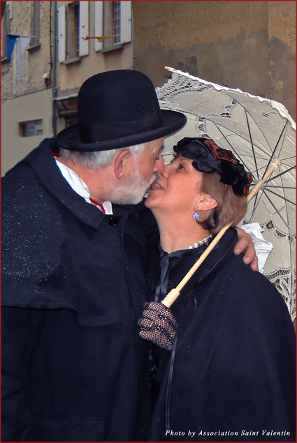 A couple kisses at the Lovers Festival in Gard, France