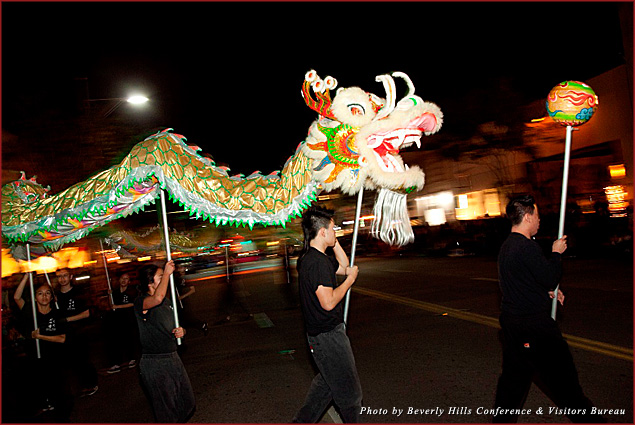 East Wind Foundation for Youth lion dance team performs on Canon Drive in Beverly Hills