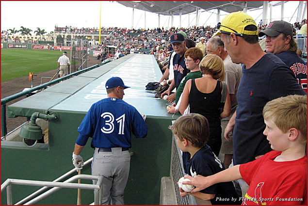 Fans get autographs from players during pre-game warm-ups at JetBlue Park in Fort Myers, home of the Boston Red Sox