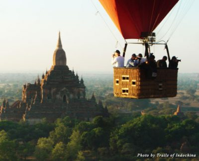 A hot air balloon overlooks the Myanmar city of Bagan