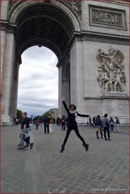 Jumping for joy in front of Paris' Arc de Triomphe