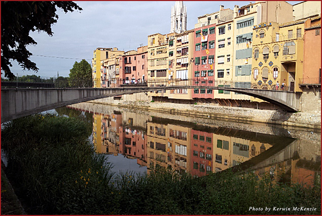A few bridges run across the river that flows through the city of Girona