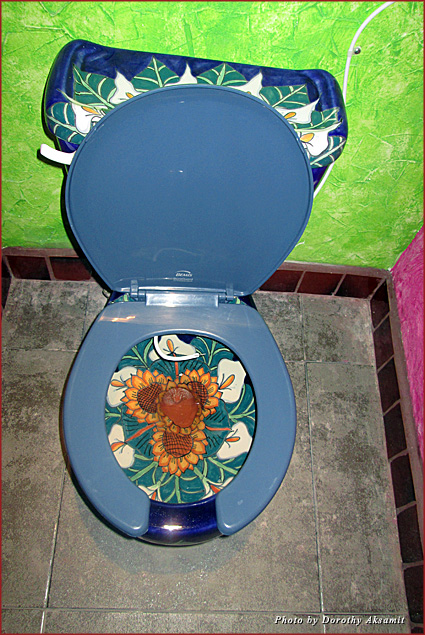 Unforgettable photo-op bathroom where lilies and sunflowers are flourishing