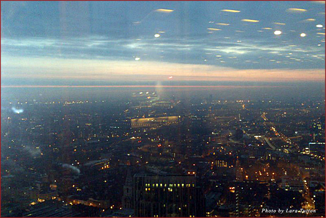 Sunrise over the city, as seen from Duck and Waffle