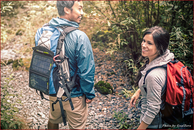 Hikers use a GoalZero solar panel while on a trek