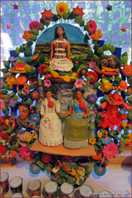 """Day of the Dead altar to Frida evoking three famous paintings: """"Broken Column,"""" """"The Two Fridas,"""" and """"Roots"""""""