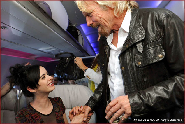 Krysten Ritter and Sir Richard Branson get ready to fly away from Los Angeles to Las Vegas on the inaugural Virgin America flight