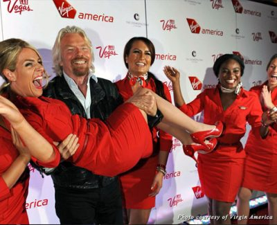 Sir Richard Branson launches Virgin America's LAX-LAS flights with the help of some pretty Virgin flight attendants