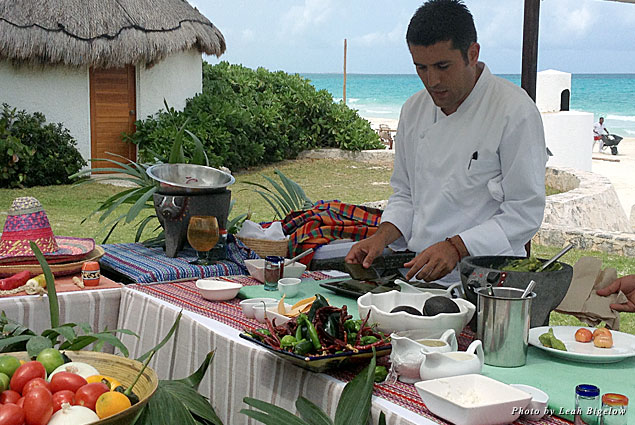 Maroma's executive chef Juan Pablo Loza prepares pescado a la barbacoa during a lunchtime cooking demonstration overlooking the beach