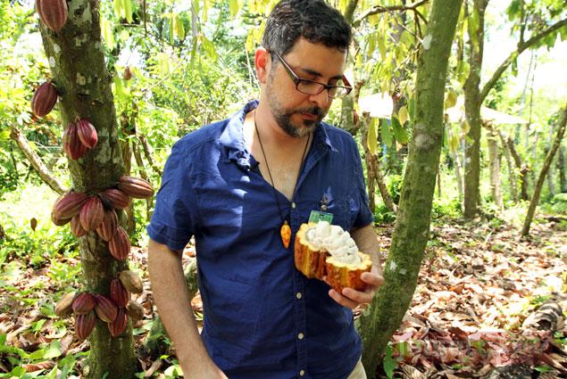 Tour guide Waldo Tejada of Tequia Experiences talks about cocoa production at Conacado